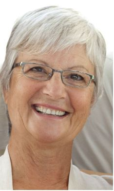 Mature woman smiling. For the woman who is battling hot flushes and sleeplessness caused by menopause, homeopathy is there to help.